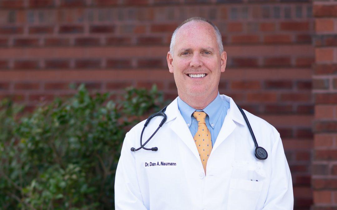 Dr. Naumann